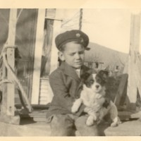 Ron at the age of 3 with his sailor's cap and dog