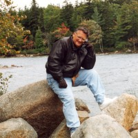 Ron is on his cell phone while on vacation at Cape Cod in 2000