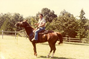 Ron riding his horse at the farm in Greenwood, AR